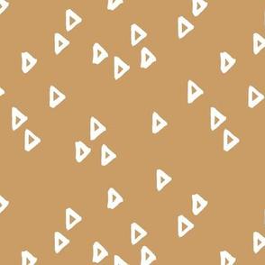 Little inky arrows abstract Scandinavian trend minimal triangles basic nursery pattern honey cinnamon