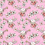 White rabbit and playing cards on pink