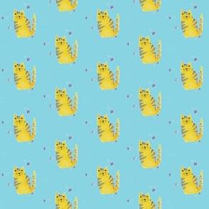 Yellow cat on blue