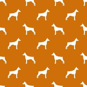 doberman silhouette fabric - rust