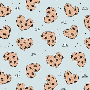 Cookies and rainbows sweet hearts shaped chocolate chip cookie bakery soft baby blue brown