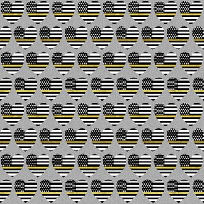 thin gold line flag in hearts on grey small scale