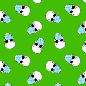 skulls in medical masks on green