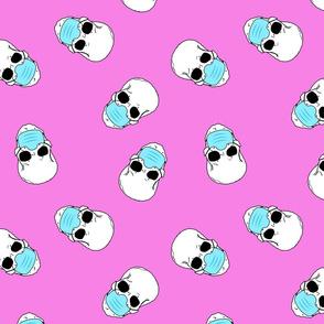 skulls in medical masks on pink