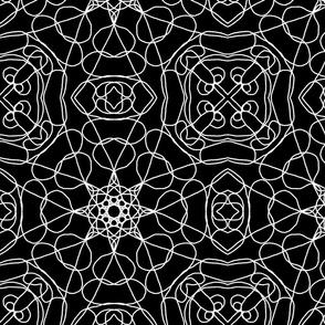 Ornamental tile design white on black
