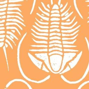 Trilobite block print, large - white on orange