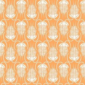 Trilobite block print, small - white on orange