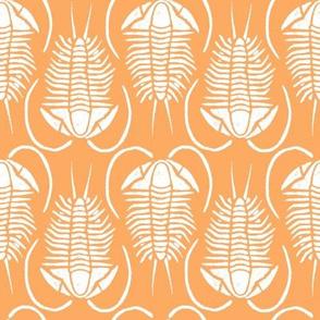 Trilobite block print white on orange (medium)