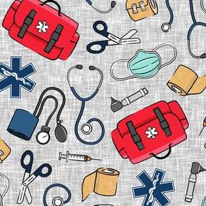 first responder EMT supplies - EMS medical fabric - red medic bag on grey - LAD20
