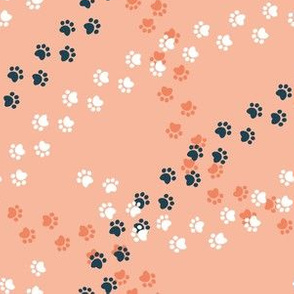 Small scale // Hot dogs chase // flesh coral background navy blue and white paw prints