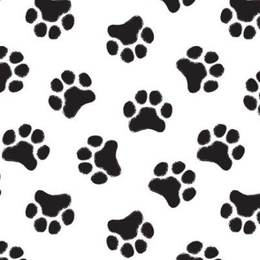 large black pawprints on white