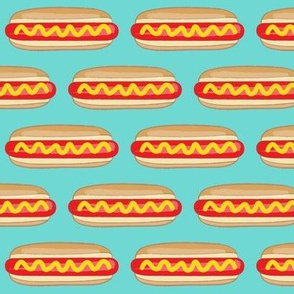 large hot dogs on teal