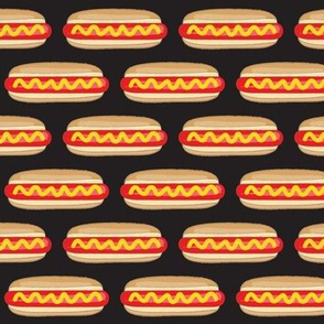 small hot dogs on black