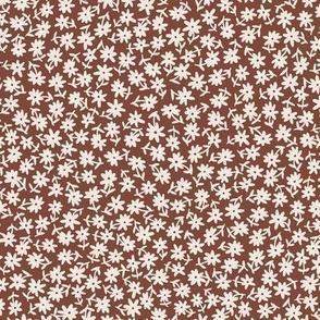 Disty floral cream on warm brown