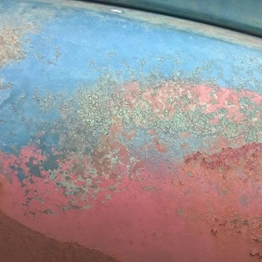 Patina on old car closeup with kaleidoscope repeat blue pink red