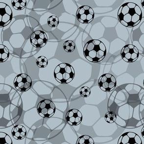 Soccer balls on grey