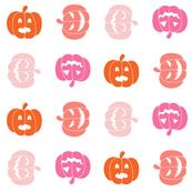 pink and orange jack o lanterns on white