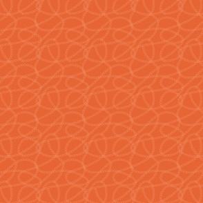 Small ringlets on burnt orange background