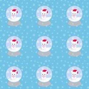 Fluffy bunny snow globe on blue