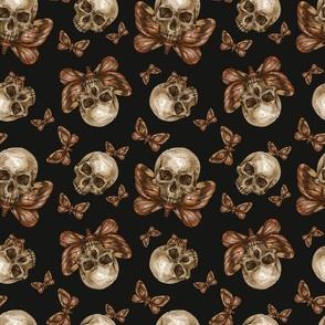 Skull and moth on black