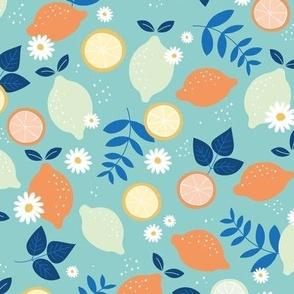 Fruit cocktail with citrus fruits lime oranges and lemons orange mint blue