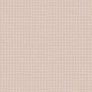 Small scale minimalistic grid on warm grey