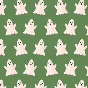 Halloween ghosts on green