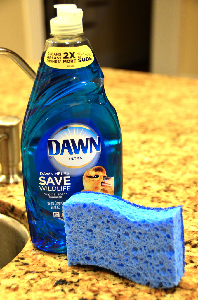 Microwave a sponge with dish soap to keep it smelling fresh