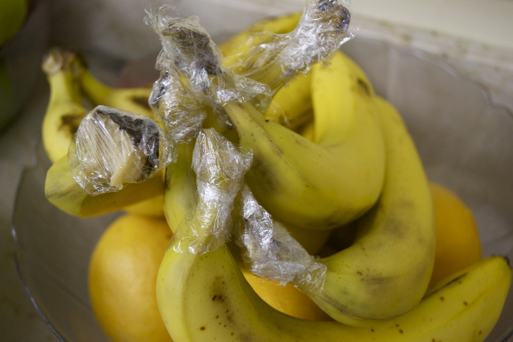 Keep bananas fresh longer by separating them and wrapping stem in plastic wrap