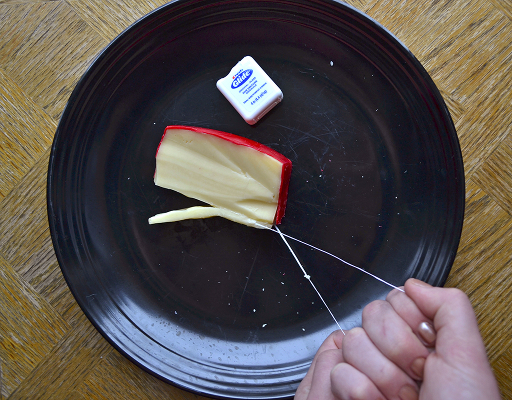 Cut soft cheeses with dental floss