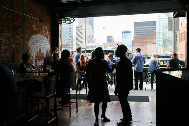 The Walrus in downtown Columbus has an open garage that leads to an outdoor patio.