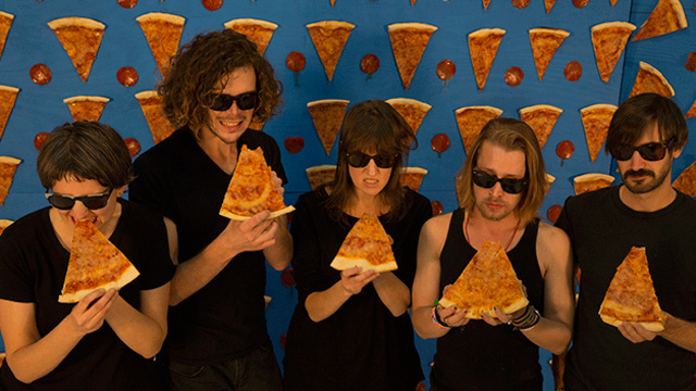 Macaulay Culkin's Pizza-Themed Cover Band Is As Weird As You'd Imagine