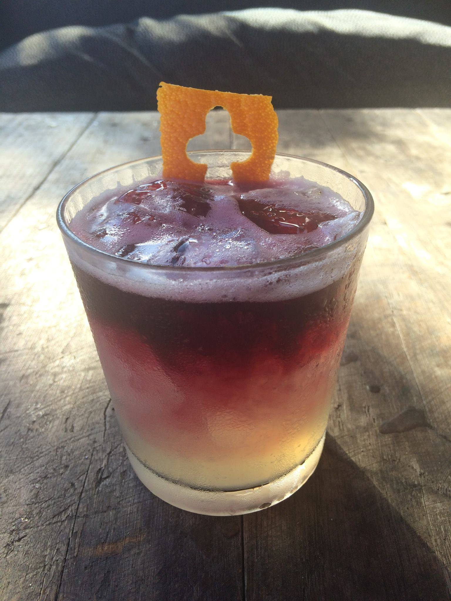 Orange Vodka, fresh squeezed lime juice, Pecan Simple Malbec Floater. Photo Courtesy of Rebel House's Facebook Page