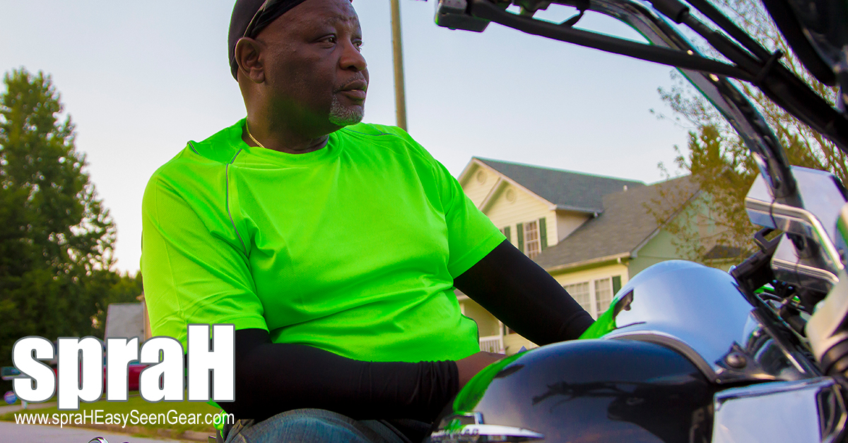 spraH Motorcycle Rider wearing the neon green spraH shirt
