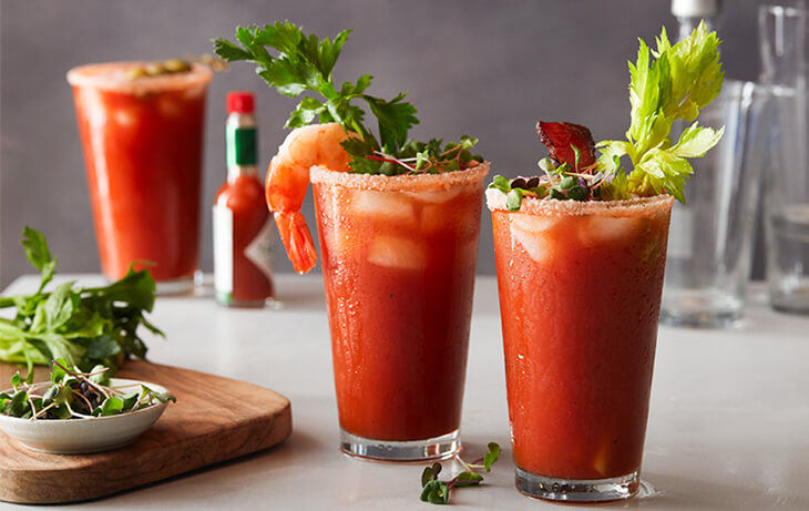2 glasses of Bloody Marys with Square Roots microgreens