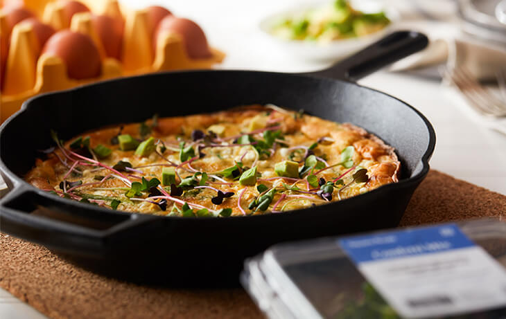 Frittata in a cast iron pan with Square Roots microgreens