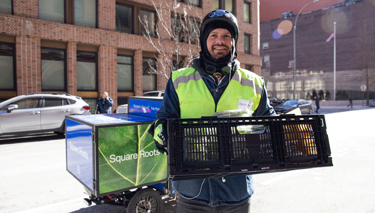 Square Roots team member Kris Liakos delivering produce around NYC.