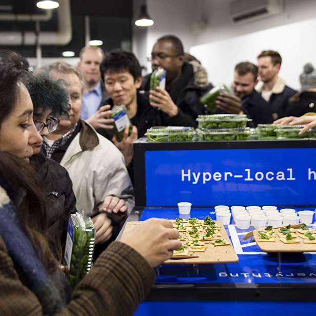 Customers sampling Square Roots hyper-local herbs at a pop-up event.