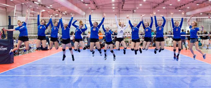 arlington elite VBC girls jumping up on volleyball court