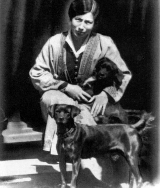 The Mother with her dogs Goro and Poochi