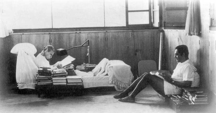 The Mother of Sri Aurobindo Ashram in her room with Pranab Kumar