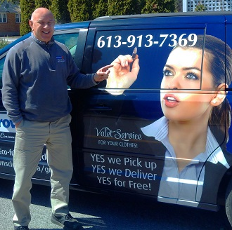 Richard from Browns Cleaners standing beside his pick-up and delivery service van.