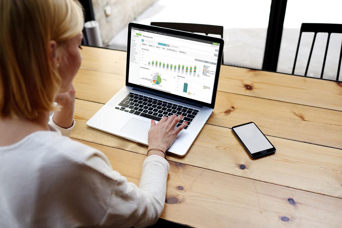 Woman at computer using the SharpSpring marketing automation platform