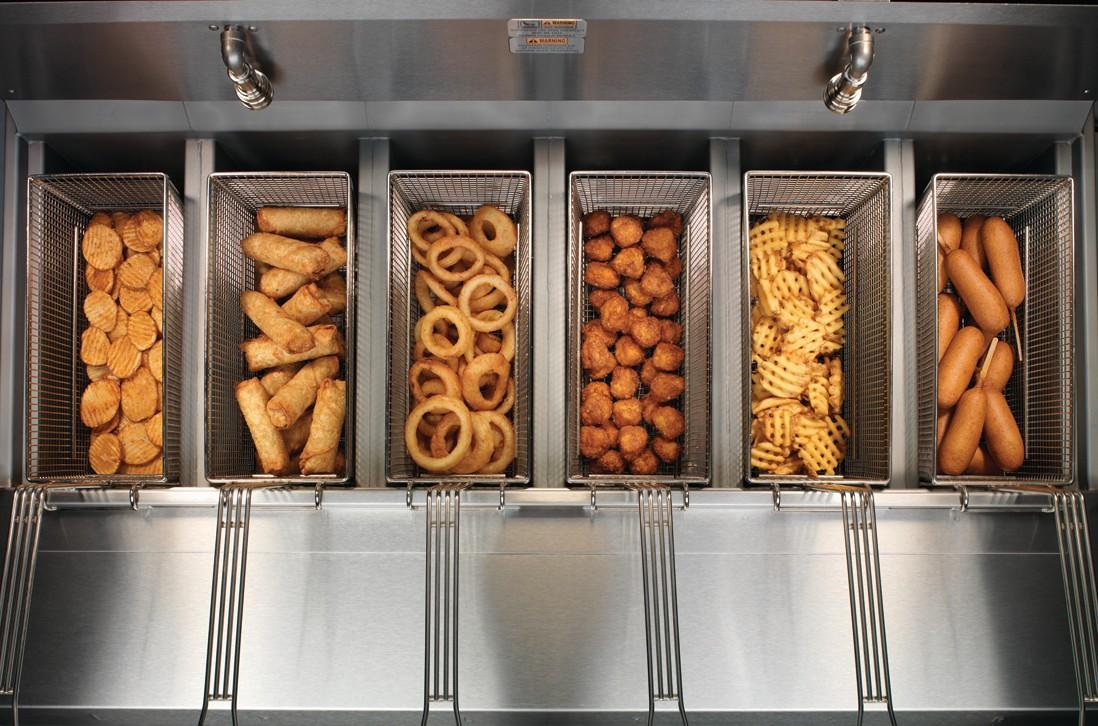 Array of fried foods in open fryer