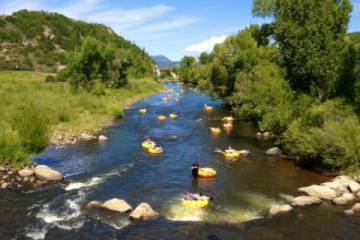 Popular summer activity of tubing the Yampa river. (Pic)