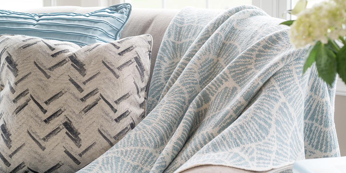 Poppy Blue Pond/Milk-  <a href='https://www.in2green.com/collections/stacy-garcia-collection/products/eco-poppy-throw' style='text-decoration: underline;'>Where to Buy</a>
