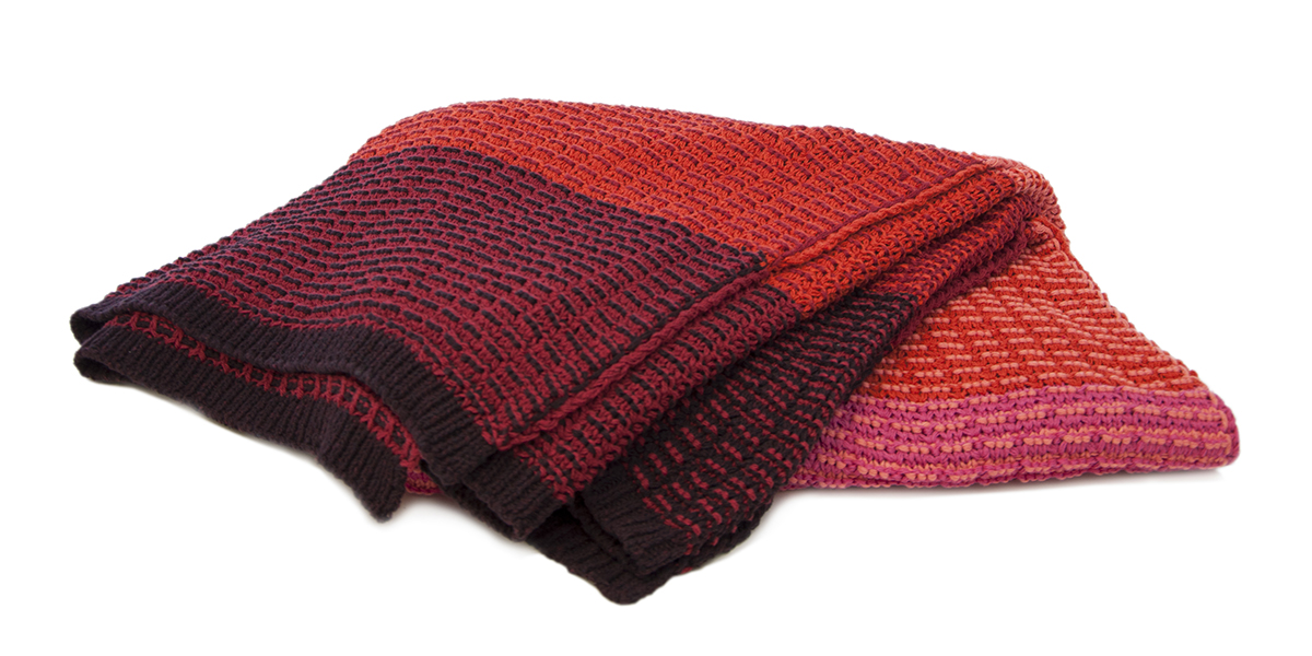 Stitch Stripe Reds-  <a href='https://www.in2green.com/collections/stacy-garcia-collection/products/eco-texture-throw' style='text-decoration: underline;'>Where to Buy</a>