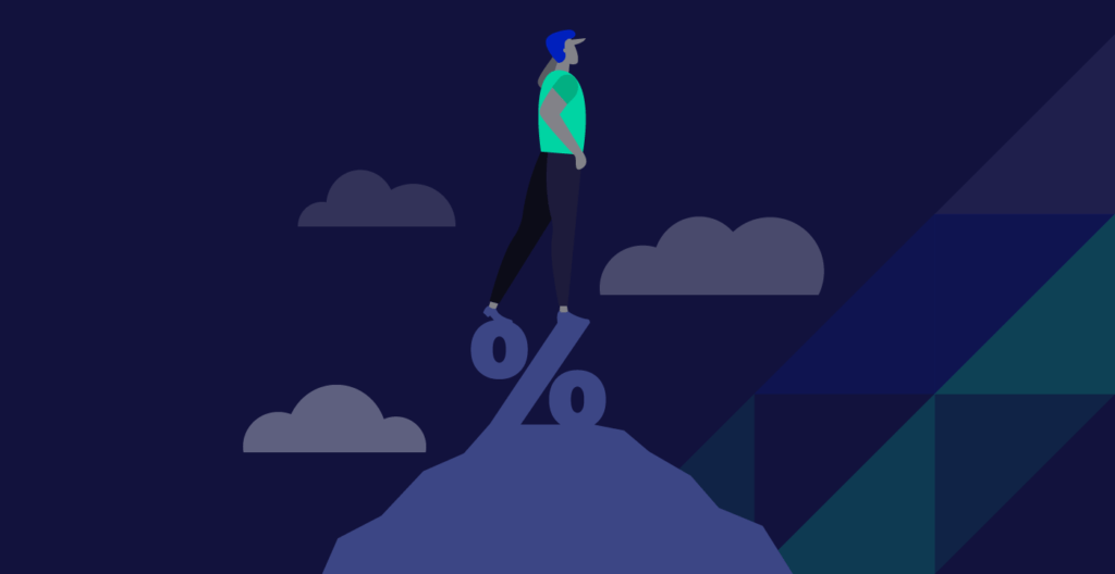 person standing on top of of a percentage sign to represent interest rates