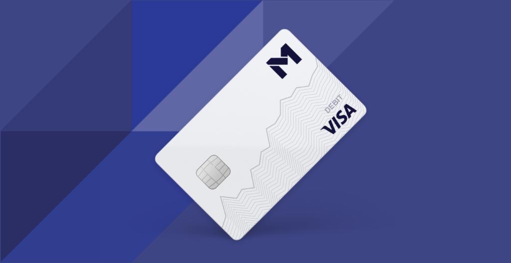 White M1 debit card over blue background