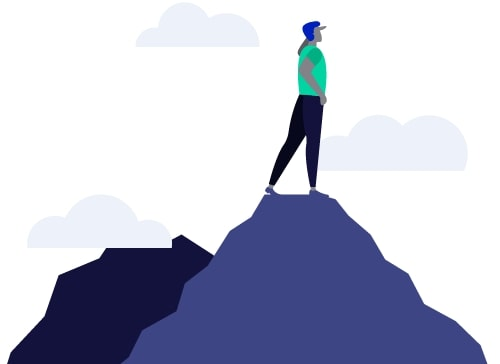 Man standing on top of a mountain, looking at the clouds.
